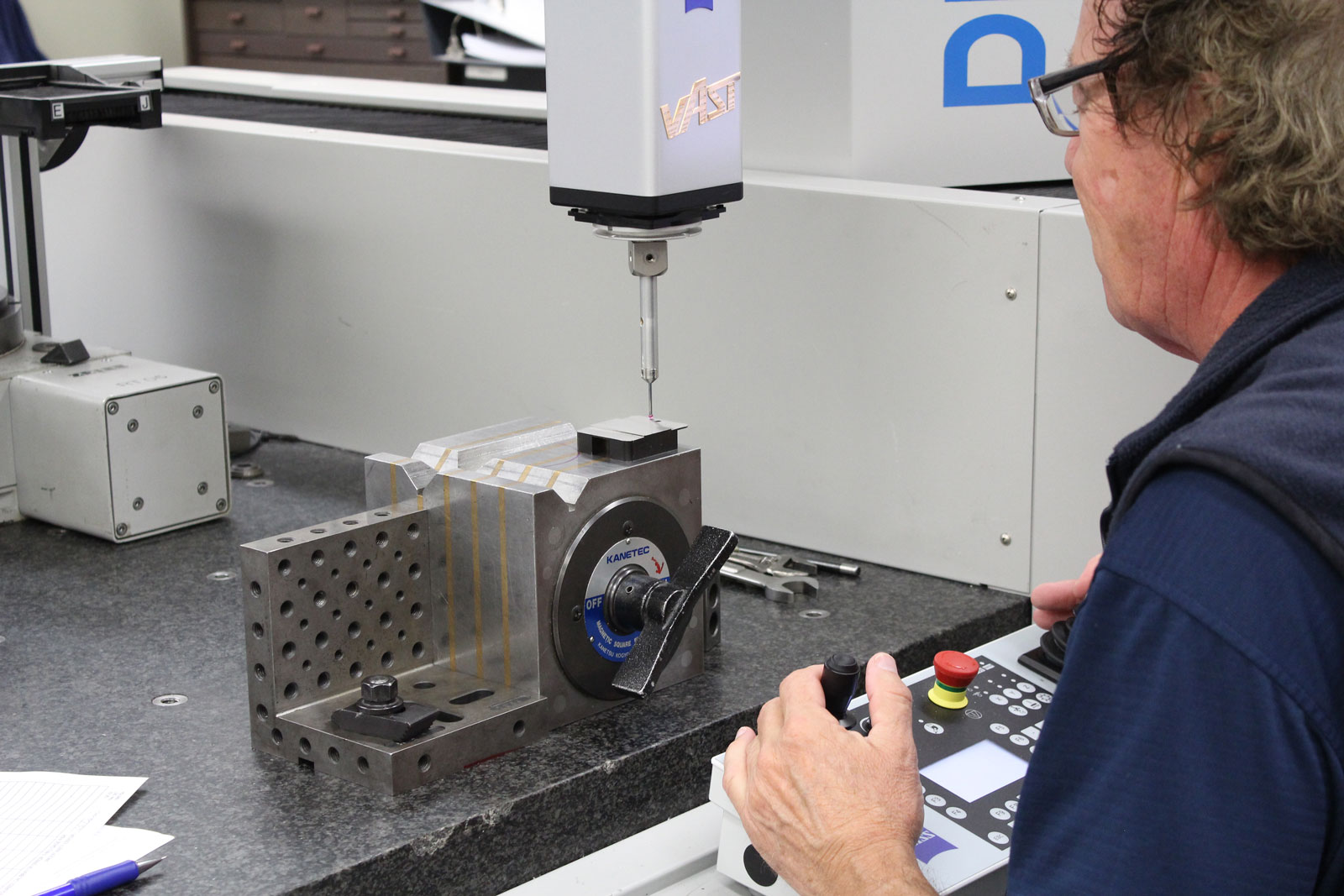 Inspection engineer using Zeiss inspection machine